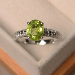 Peridot ring, engagement ring, natural peridot, oval cut peridot ring, green gemstone ring | Natural genuine Array rings, simple unique alternative gemstone engagement rings. #rings #jewelry #bridal #wedding #jewelryaccessories #engagementrings #weddingideas #affiliate #ad