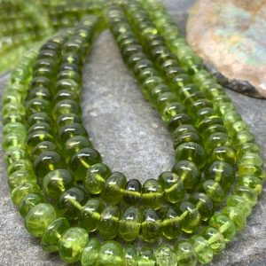 Natural Green Peridot Green Smooth Large Rondelle Spacer Beads / Natural Peridot Gemstone Beads / 4-5mm | Natural genuine rondelle Peridot beads for beading and jewelry making.  #jewelry #beads #beadedjewelry #diyjewelry #jewelrymaking #beadstore #beading #affiliate #ad