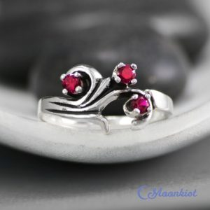 Shop Ruby Jewelry! Curved Three Stone Ring, Sterling Silver Ruby Anniversary Ring, Unique Mothers Ring, July Birthstone Ring | Moonkist Designs | Natural genuine Ruby jewelry. Buy crystal jewelry, handmade handcrafted artisan jewelry for women.  Unique handmade gift ideas. #jewelry #beadedjewelry #beadedjewelry #gift #shopping #handmadejewelry #fashion #style #product #jewelry #affiliate #ad