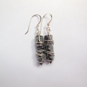 Shop Snowflake Obsidian Earrings! Snowflake Obsidian Points Wire Wrapped Sterling Silver Dangle Earrings. | Natural genuine Snowflake Obsidian earrings. Buy crystal jewelry, handmade handcrafted artisan jewelry for women.  Unique handmade gift ideas. #jewelry #beadedearrings #beadedjewelry #gift #shopping #handmadejewelry #fashion #style #product #earrings #affiliate #ad
