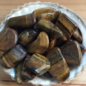 Shop Tiger Eye Stones & Crystals! Tiger's Eye Small Healing Stone, Healing Crystal, Chakra Stone, Spiritual Stone | Natural genuine stones & crystals in various shapes & sizes. Buy raw cut, tumbled, or polished gemstones for making jewelry or crystal healing energy vibration raising reiki stones. #crystals #gemstones #crystalhealing #crystalsandgemstones #energyhealing #affiliate #ad