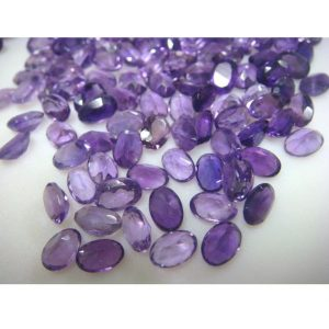 Shop Amethyst Cabochons! Amethyst Cabochon, Faceted Cabochons, Oval Faceted Calibrated African Amethyst – 5x7mm Each – 20 Ctw – 35 Pieces | Natural genuine stones & crystals in various shapes & sizes. Buy raw cut, tumbled, or polished gemstones for making jewelry or crystal healing energy vibration raising reiki stones. #crystals #gemstones #crystalhealing #crystalsandgemstones #energyhealing #affiliate #ad