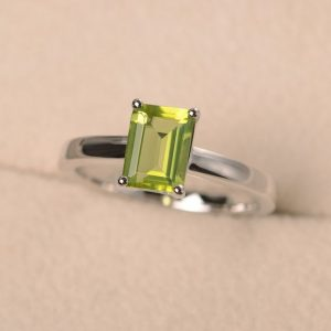 Shop Peridot Rings! Green peridot ring, August birthstone ring, emerald cut ring, promising ring for her, solitaire ring | Natural genuine Peridot rings, simple unique handcrafted gemstone rings. #rings #jewelry #shopping #gift #handmade #fashion #style #affiliate #ad