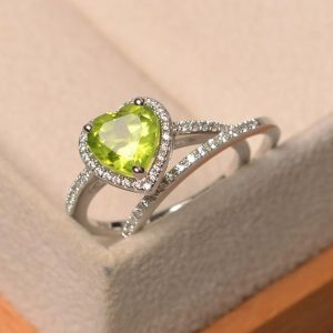 Shop Peridot Rings! Green peridot ring, August birthstone, heart cut halo ring, bridal sets, sterling silver wedding ring | Natural genuine Peridot rings, simple unique alternative gemstone engagement rings. #rings #jewelry #bridal #wedding #jewelryaccessories #engagementrings #weddingideas #affiliate #ad
