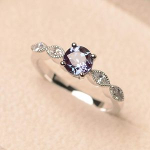 Shop Alexandrite Jewelry! Alexandrite ring, June birthstone ring, color changing gemstone ring, round cut ring, silver engagement ring | Natural genuine Alexandrite jewelry. Buy handcrafted artisan wedding jewelry.  Unique handmade bridal jewelry gift ideas. #jewelry #beadedjewelry #gift #crystaljewelry #shopping #handmadejewelry #wedding #bridal #jewelry #affiliate #ad