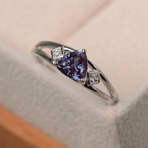 Shop Alexandrite Rings! Alexandrite Ring, Wedding Ring, Trillion Cut Color Changing Gemstone, June Birthstone, Sterling Silver Ring | Natural genuine Alexandrite rings, simple unique alternative gemstone engagement rings. #rings #jewelry #bridal #wedding #jewelryaccessories #engagementrings #weddingideas #affiliate #ad