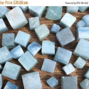 Shop Tumbled Aquamarine Crystals & Pocket Stones! On Vacay: 1 / 4 Lb Aquamarine Cubes / Blue Beryl Polished Tumbled Cube Quarter Pound | Natural genuine stones & crystals in various shapes & sizes. Buy raw cut, tumbled, or polished gemstones for making jewelry or crystal healing energy vibration raising reiki stones. #crystals #gemstones #crystalhealing #crystalsandgemstones #energyhealing #affiliate #ad