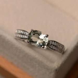 Shop Green Amethyst Rings! Green amethyst ring, east to west ring, oval shape green quartz ring, engagement ring for her, silver ring | Natural genuine Green Amethyst rings, simple unique alternative gemstone engagement rings. #rings #jewelry #bridal #wedding #jewelryaccessories #engagementrings #weddingideas #affiliate #ad