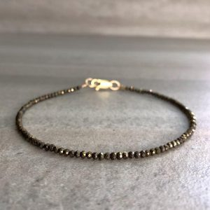 Shop Pyrite Jewelry! Pyrite Bracelet | Tiny Bead Bracelet For Women, Men | Natural Semi Precious Stones | Faceted Gemstone Bracelet | Silver Or Gold Clasp | Natural genuine Pyrite jewelry. Buy crystal jewelry, handmade handcrafted artisan jewelry for women.  Unique handmade gift ideas. #jewelry #beadedjewelry #beadedjewelry #gift #shopping #handmadejewelry #fashion #style #product #jewelry #affiliate #ad