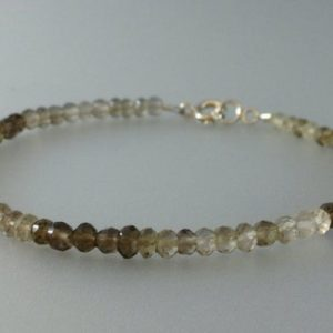 Shop Smoky Quartz Bracelets! Faceted shaded smokey Quartz bracelet with Sterling silver clasp – gift idea – ombre bracelet – natural gemstones – dark to light – brown | Natural genuine Smoky Quartz bracelets. Buy crystal jewelry, handmade handcrafted artisan jewelry for women.  Unique handmade gift ideas. #jewelry #beadedbracelets #beadedjewelry #gift #shopping #handmadejewelry #fashion #style #product #bracelets #affiliate #ad