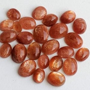 Shop Sunstone Stones & Crystals! 6x8mm – 9x11mm Sunstone Oval Flat Back Cabochons, Natural Loose Sunstone Plain Oval Cabochons, 5 Pcs Sunstone For Jewelry – Pdg140 | Natural genuine stones & crystals in various shapes & sizes. Buy raw cut, tumbled, or polished gemstones for making jewelry or crystal healing energy vibration raising reiki stones. #crystals #gemstones #crystalhealing #crystalsandgemstones #energyhealing #affiliate #ad