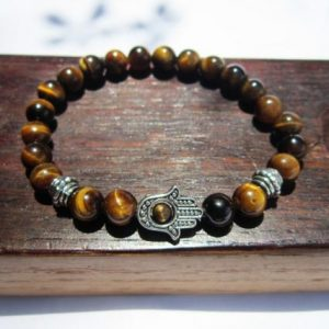 Shop Tiger Eye Bracelets! Hamsa Hand Tiger Eye Bracelet Tiger Eye Fatima Hand Bracelet Hamsa Hand Charm Tiger Eye Bracelet Hamsa Hand Tiger Eye Protection Bracelet | Natural genuine Tiger Eye bracelets. Buy crystal jewelry, handmade handcrafted artisan jewelry for women.  Unique handmade gift ideas. #jewelry #beadedbracelets #beadedjewelry #gift #shopping #handmadejewelry #fashion #style #product #bracelets #affiliate #ad