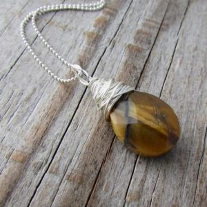 Shop Tiger Eye Pendants! Tiger Eye Pendant, tigers eye, wire wrapped, faceted stone necklace | Natural genuine Tiger Eye pendants. Buy crystal jewelry, handmade handcrafted artisan jewelry for women.  Unique handmade gift ideas. #jewelry #beadedpendants #beadedjewelry #gift #shopping #handmadejewelry #fashion #style #product #pendants #affiliate #ad
