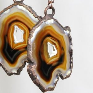 Shop Agate Necklaces! Agate Slice Necklace – Long Copper and Stone Necklace – Copper Edged Stone | Natural genuine Agate necklaces. Buy crystal jewelry, handmade handcrafted artisan jewelry for women.  Unique handmade gift ideas. #jewelry #beadednecklaces #beadedjewelry #gift #shopping #handmadejewelry #fashion #style #product #necklaces #affiliate #ad