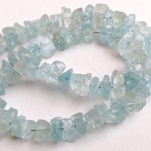 Shop Aquamarine Chip & Nugget Beads! 8 Inch Raw Aquamarine Stones, 6-8mm Natural Aquamarine Rough Beads Side Drilled, 62 Pcs Aqua Rough Nuggets, Aquamarine Jewelry – Pdg201 | Natural genuine chip Aquamarine beads for beading and jewelry making.  #jewelry #beads #beadedjewelry #diyjewelry #jewelrymaking #beadstore #beading #affiliate #ad