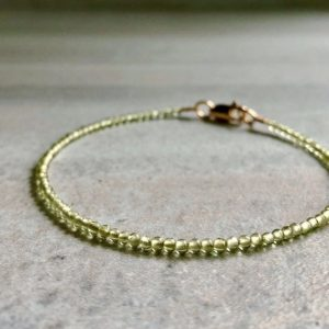 Shop Peridot Bracelets! Gold Peridot Bracelet | Tiny Bead Bracelet for Women, Men | 5 6 7 8 9 Inch Size for Small or Large Wrists | Natural Crystal Jewelry | Natural genuine Peridot bracelets. Buy crystal jewelry, handmade handcrafted artisan jewelry for women.  Unique handmade gift ideas. #jewelry #beadedbracelets #beadedjewelry #gift #shopping #handmadejewelry #fashion #style #product #bracelets #affiliate #ad