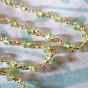 Shop Peridot Rondelle Beads! Peridot Rosary Chain By The Foot, Wire Wrapped Rondelles Gemstone Chain, Silver Or Gold Plated, Wholesale Pricing, Jewelry Craft Chain Rc.12 | Natural genuine rondelle Peridot beads for beading and jewelry making.  #jewelry #beads #beadedjewelry #diyjewelry #jewelrymaking #beadstore #beading #affiliate #ad