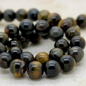 Shop Tiger Eye Round Beads! Blue Tiger Tiger's Eye Smooth Round Gemstone Beads (4mm 6mm 8mm 10mm) | Natural genuine round Tiger Eye beads for beading and jewelry making.  #jewelry #beads #beadedjewelry #diyjewelry #jewelrymaking #beadstore #beading #affiliate #ad