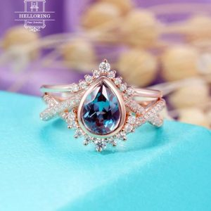 Shop Alexandrite Rings! Alexandrite Engagement Ring Set Rose Gold Women, Vintage Wedding Ring, Pear Shaped, curved Diamond / Moissanite Band, anniversary Gifts For Her | Natural genuine Alexandrite rings, simple unique alternative gemstone engagement rings. #rings #jewelry #bridal #wedding #jewelryaccessories #engagementrings #weddingideas #affiliate #ad