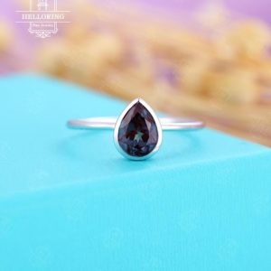 Shop Alexandrite Jewelry! Pear shaped Alexandrite Engagement ring, white gold rings for , solitaire engagement ring,simple bridal , Anniversary s | Natural genuine Alexandrite jewelry. Buy handcrafted artisan wedding jewelry.  Unique handmade bridal jewelry gift ideas. #jewelry #beadedjewelry #gift #crystaljewelry #shopping #handmadejewelry #wedding #bridal #jewelry #affiliate #ad