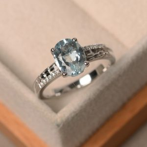 Aquamarine ring, oval blue aquamarine ring, natural blue gemstone, March birthstone, engagement ring | Natural genuine Array rings, simple unique alternative gemstone engagement rings. #rings #jewelry #bridal #wedding #jewelryaccessories #engagementrings #weddingideas #affiliate #ad