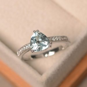 Shop Aquamarine Engagement Rings! Aquamarine ring, triangle cut engagement ring, March birthstone, natural aquamarine | Natural genuine Aquamarine rings, simple unique alternative gemstone engagement rings. #rings #jewelry #bridal #wedding #jewelryaccessories #engagementrings #weddingideas #affiliate #ad
