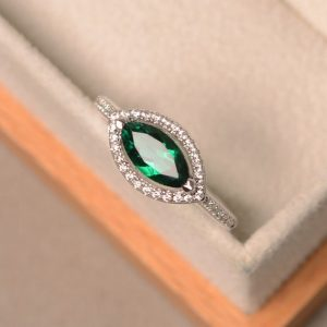 Lab grown emerald ring, sterling silver, marquise cut ring, engagement ring, halo ring, straight shank ring | Natural genuine Array rings, simple unique alternative gemstone engagement rings. #rings #jewelry #bridal #wedding #jewelryaccessories #engagementrings #weddingideas #affiliate #ad