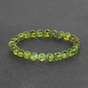 Shop Peridot Bracelets! Dainty Peridot Bracelet Handmade 7mm Genuine Olivine Peridot Grade AAA Beaded Natural Gemstone Bracelet Green Olive Peridot Gift Bracelet | Natural genuine Peridot bracelets. Buy crystal jewelry, handmade handcrafted artisan jewelry for women.  Unique handmade gift ideas. #jewelry #beadedbracelets #beadedjewelry #gift #shopping #handmadejewelry #fashion #style #product #bracelets #affiliate #ad