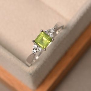 Shop Peridot Rings! Natural peridot ring, square cut, engagement, promise ring, August birthstone, sterling silver | Natural genuine Peridot rings, simple unique alternative gemstone engagement rings. #rings #jewelry #bridal #wedding #jewelryaccessories #engagementrings #weddingideas #affiliate #ad