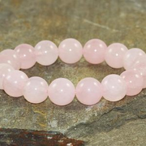 Shop Rose Quartz Bracelets! 10mm A+ Grade Rose Quartz Bracelet, Heart Chakra Jewelry, Healing Crystals, Gemstone Bracelet, Pink, Unconditional Love-Compassion-Kindness | Natural genuine Rose Quartz bracelets. Buy crystal jewelry, handmade handcrafted artisan jewelry for women.  Unique handmade gift ideas. #jewelry #beadedbracelets #beadedjewelry #gift #shopping #handmadejewelry #fashion #style #product #bracelets #affiliate #ad