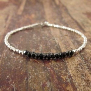 Shop Spinel Bracelets! Black Spinel Bracelet, Black Beaded Bracelets for Women, Black Spinel Jewelry, Simple Silver Beaded Bracelet, Black Spinel Gemstone Jewelry | Natural genuine Spinel bracelets. Buy crystal jewelry, handmade handcrafted artisan jewelry for women.  Unique handmade gift ideas. #jewelry #beadedbracelets #beadedjewelry #gift #shopping #handmadejewelry #fashion #style #product #bracelets #affiliate #ad