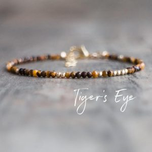 Shop Tiger Eye Jewelry! Tiger's Eye Bracelet, Gift For Mother, Skinny Stacking Bracelet, Gemstone Jewelry, Healing Crystal Bracelet | Natural genuine Tiger Eye jewelry. Buy crystal jewelry, handmade handcrafted artisan jewelry for women.  Unique handmade gift ideas. #jewelry #beadedjewelry #beadedjewelry #gift #shopping #handmadejewelry #fashion #style #product #jewelry #affiliate #ad