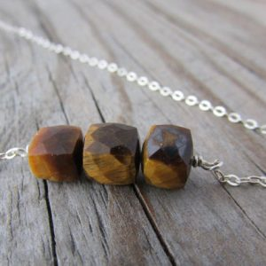 Shop Tiger Eye Necklaces! Tiger Eye Necklace, faceted gemstone cubes of tigers eye, silver necklace | Natural genuine Tiger Eye necklaces. Buy crystal jewelry, handmade handcrafted artisan jewelry for women.  Unique handmade gift ideas. #jewelry #beadednecklaces #beadedjewelry #gift #shopping #handmadejewelry #fashion #style #product #necklaces #affiliate #ad