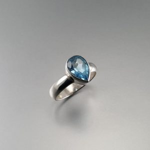 Shop Topaz Engagement Rings! Blue topaz teardrop ring with silver gift for her – November birthstone – gemstone engagement ring | Natural genuine Topaz rings, simple unique alternative gemstone engagement rings. #rings #jewelry #bridal #wedding #jewelryaccessories #engagementrings #weddingideas #affiliate #ad