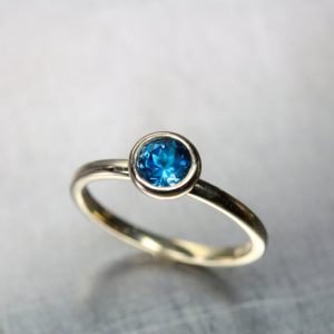 Minimalistic London Blue Topaz Engagement Ring 14K Yellow Gold Modern Simple Bridal Setting Deep Intense Color Wedding Band – Cerulean Cup | Natural genuine Gemstone rings, simple unique alternative gemstone engagement rings. #rings #jewelry #bridal #wedding #jewelryaccessories #engagementrings #weddingideas #affiliate #ad