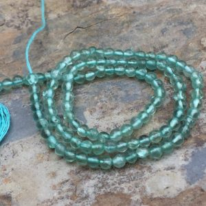 Shop Apatite Round Beads! Round Apatite Beads, Aqua Apatite Beads, smooth, 3mm, 13 inch strand | Natural genuine round Apatite beads for beading and jewelry making.  #jewelry #beads #beadedjewelry #diyjewelry #jewelrymaking #beadstore #beading #affiliate #ad