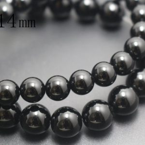Shop Onyx Round Beads! 14mm Natural Black Onyx Beads,Natural Smooth and Round  Beads,15 inches one starand | Natural genuine round Onyx beads for beading and jewelry making.  #jewelry #beads #beadedjewelry #diyjewelry #jewelrymaking #beadstore #beading #affiliate #ad