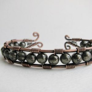 Shop Pyrite Bracelets! Copper Wire Wrapped Cuff Bracelet with Metallic Pyrite | Natural genuine Pyrite bracelets. Buy crystal jewelry, handmade handcrafted artisan jewelry for women.  Unique handmade gift ideas. #jewelry #beadedbracelets #beadedjewelry #gift #shopping #handmadejewelry #fashion #style #product #bracelets #affiliate #ad