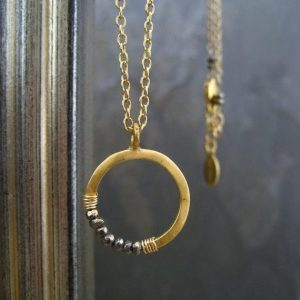 Shop Healing Gemstone & Crystal Pendants! Pyrite necklace, circle pendant, crescent necklace, moon pendant, layering necklace, half moon, round pendant, gold circle pendant | Natural genuine Gemstone pendants. Buy crystal jewelry, handmade handcrafted artisan jewelry for women.  Unique handmade gift ideas. #jewelry #beadedpendants #beadedjewelry #gift #shopping #handmadejewelry #fashion #style #product #pendants #affiliate #ad