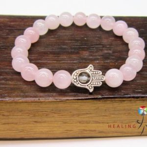Shop Rose Quartz Bracelets! Hamsa Hand Rose Quartz Fatima Hand Bracelet Hamsa Charm Bracelet Protection Bracelet Hamsa Hand Rose Quartz Bracelet Rose Quartz Bracelet | Natural genuine Rose Quartz bracelets. Buy crystal jewelry, handmade handcrafted artisan jewelry for women.  Unique handmade gift ideas. #jewelry #beadedbracelets #beadedjewelry #gift #shopping #handmadejewelry #fashion #style #product #bracelets #affiliate #ad