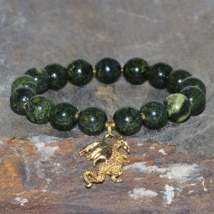Shop Serpentine Jewelry! Chunky Serpentine Bracelet Handmade 10mm Green Snake Skin Russian Serpentine Beaded Gemstone Bracelet Gold Dragon Bracelet Unisex Bracelet | Natural genuine Serpentine jewelry. Buy crystal jewelry, handmade handcrafted artisan jewelry for women.  Unique handmade gift ideas. #jewelry #beadedjewelry #beadedjewelry #gift #shopping #handmadejewelry #fashion #style #product #jewelry #affiliate #ad