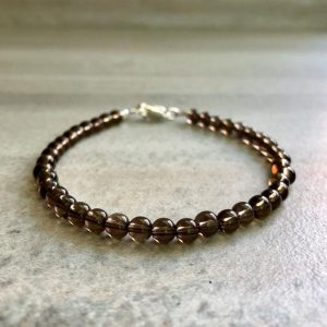 Shop Smoky Quartz Bracelets! Smoky Quartz Jewelry For Men, Women | 5 6 7 8 9 Inch Bracelet For Small Or Large Wrists | Silver Or Gold Clasp | Healing Crystal Quartz | Natural genuine Smoky Quartz bracelets. Buy handcrafted artisan men's jewelry, gifts for men.  Unique handmade mens fashion accessories. #jewelry #beadedbracelets #beadedjewelry #shopping #gift #handmadejewelry #bracelets #affiliate #ad