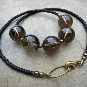 Shop Smoky Quartz Necklaces! Chunky Smoky Quartz Necklace, bold yet neutral brown gray quartz crystal necklace with matte black beaded chain | Natural genuine Smoky Quartz necklaces. Buy crystal jewelry, handmade handcrafted artisan jewelry for women.  Unique handmade gift ideas. #jewelry #beadednecklaces #beadedjewelry #gift #shopping #handmadejewelry #fashion #style #product #necklaces #affiliate #ad