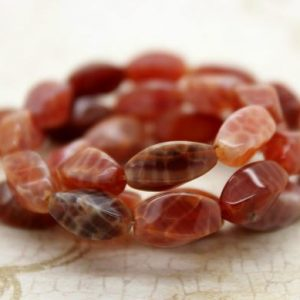 Shop Red Agate Beads! Fire Agate, Red Fire Agate Twisted Oval Smooth Loose Gemstone Beads – 12mm x 6mm – Full Strand | Natural genuine beads Agate beads for beading and jewelry making.  #jewelry #beads #beadedjewelry #diyjewelry #jewelrymaking #beadstore #beading #affiliate #ad