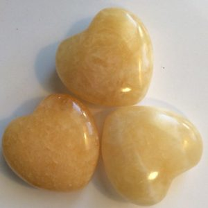 Shop Tumbled Calcite Crystals & Pocket Stones! Orange Calcite Small Gemstone Puffy Heart, 30mm, Tumbled Stone, Healing Stone, Healing Crystal, Chakra Stones, Spiritual Stone | Natural genuine stones & crystals in various shapes & sizes. Buy raw cut, tumbled, or polished gemstones for making jewelry or crystal healing energy vibration raising reiki stones. #crystals #gemstones #crystalhealing #crystalsandgemstones #energyhealing #affiliate #ad