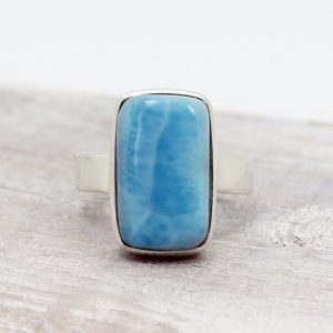 Shop Larimar Rings! Bright Blue Larimar Ring Rectangular Shape Simple Mount Genuine Larimar Cab Stone Set On 925 Sterling Silver Great Quality Nickel Free | Natural genuine Larimar rings, simple unique handcrafted gemstone rings. #rings #jewelry #shopping #gift #handmade #fashion #style #affiliate #ad