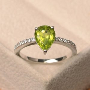 Natural peridot ring, pear cut green gemstone, sterling silver ring, August birthstone, engagement ring, | Natural genuine Gemstone rings, simple unique alternative gemstone engagement rings. #rings #jewelry #bridal #wedding #jewelryaccessories #engagementrings #weddingideas #affiliate #ad