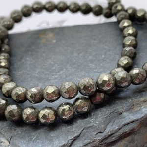 Shop Pyrite Faceted Beads! Natural Gold Pyrite Faceted Round Beads 6mm | Natural genuine faceted Pyrite beads for beading and jewelry making.  #jewelry #beads #beadedjewelry #diyjewelry #jewelrymaking #beadstore #beading #affiliate #ad