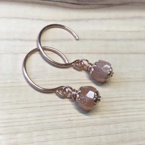 Shop Sunstone Earrings! Tiny Sunstone Earrings On Copper Hoops | Natural genuine Sunstone earrings. Buy crystal jewelry, handmade handcrafted artisan jewelry for women.  Unique handmade gift ideas. #jewelry #beadedearrings #beadedjewelry #gift #shopping #handmadejewelry #fashion #style #product #earrings #affiliate #ad