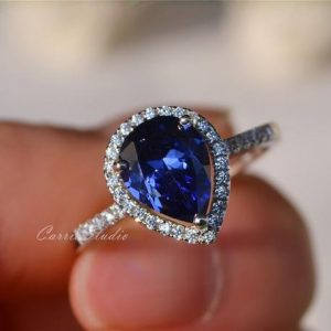 Shop Tanzanite Jewelry! Pear Tanzanite Ring Tanzanite Engagement Ring Wedding Ring Anniversary Ring Promise Ring | Natural genuine Tanzanite jewelry. Buy handcrafted artisan wedding jewelry.  Unique handmade bridal jewelry gift ideas. #jewelry #beadedjewelry #gift #crystaljewelry #shopping #handmadejewelry #wedding #bridal #jewelry #affiliate #ad